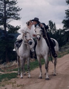 horseback bride and groom